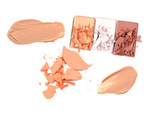 Collection of various make up powder samples on white background. Stock Photo