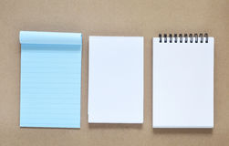 Collection of various note paper. On brown background Royalty Free Stock Photo
