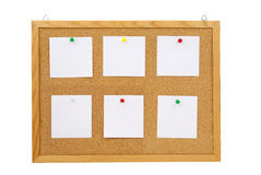 Collection of various note papers on cork board Stock Images