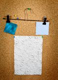 Collection of various note papers on cork board. Paper of note with tack on cork noticeboard Royalty Free Stock Image