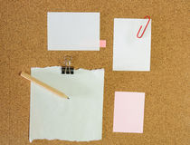 Collection of various note papers on cork board Royalty Free Stock Images