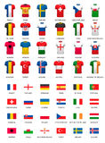 Collection of various soccer jerseys and flags of countries. Royalty Free Stock Photos