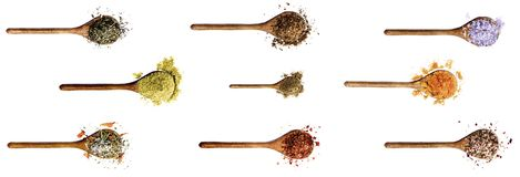 Collection of Spices. Collection of Various Spices in Wooden Spoons: Thyme, Cumin Powder, Salt with Petals, Dried Paprika, Zira, Salt with Cayenne Pepper, Kosher stock photos