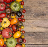 Collection of various tomatoes on wooden background Royalty Free Stock Photography