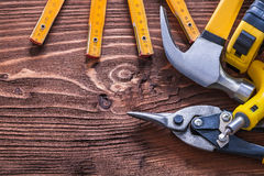 Collection of various working tools on wood board Stock Images