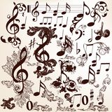 Collection of vector decorative music elements with swirls and t Royalty Free Stock Image