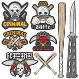 Collection of vector gang and criminal badges. Set of agressive gang and criminal badges. Skulls, crossed knives, pistols and baseball bats, sample text. Flat Royalty Free Stock Photos