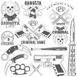 Collection of vector gang and criminal logotypes. Set of agressive gang and criminal logotypes. Skulls, crossed knives and pistols, baseball bats, brass knuckles Royalty Free Stock Image