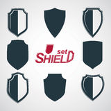 Collection of vector grayscale defense shields, protection design graphic elements. Royalty Free Stock Photography