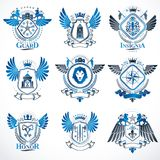 Collection of vector heraldic decorative coat of arms isolated o. N white and created using vintage design elements, monarch crowns, pentagonal stars, armory Royalty Free Stock Image