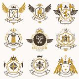 Collection of vector heraldic decorative coat of arms isolated o. N white and created using vintage design elements, monarch crowns, pentagonal stars, armory Royalty Free Stock Images