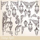 Collection of vector street lamps and calligraphic elements. Collection or set of vintage hand drawn lights street lamps in engraved retro style stock illustration