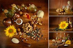 Collection vegetable oils and seeds on dark wooden surface. Stock Photo