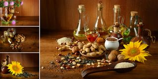 Collection vegetable oils and seeds on dark wooden table. royalty free stock images