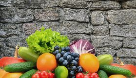Collection vegetables and fruits on background dark stone wall i Stock Photos