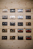 Collection of vintage Compact Cassettes on Wooden background Stock Photography