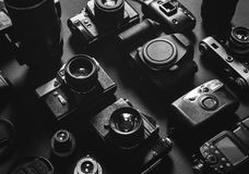 Collection Vintage Film And Digital Cameras Top View Black And White Royalty Free Stock Photos