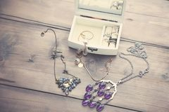 Necklaces and Boxes. A collection of vintage jewelry in antique wooden jewelry box Stock Photo