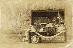 A collection of vintage jewelry in antique wooden jewelry box. retro filtered image. Old style photo. Stock Photos
