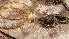 A collection of vintage jewelry on table.  stock footage
