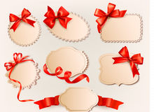 Collection of vintage labels with a red gift bows Royalty Free Stock Photography