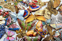 Collection of vintage and modern enameled butterfly brooches, pins Stock Photo