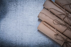 Collection of vintage paper rolls on scratched Stock Image
