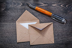 Collection of vintage post envelopes fountain pen on wooden boar Royalty Free Stock Image