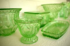 Collection: vintage 1930s green glass bowls. Collection of vintage 1930s green glass vases, bowls and tray Royalty Free Stock Photography