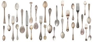 Collection vintage spoons, forks and knife isolated on a white background. royalty free stock photo