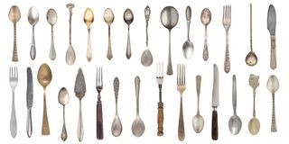 Collection vintage spoons, forks and knife isolated on a white background. Retro silverware royalty free stock image