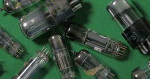 A collection of vintage vacuum tubes valves tor music amplifiers manufactured in the forties stock footage
