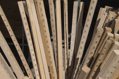 Collection of Vintage Wooden Rulers. A group of wooden yardsticks stored together in a bin stock photo
