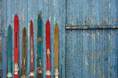 Collection of vintage wooden weathered ski's. In front of an old barn Royalty Free Stock Photos