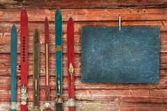 Collection of vintage wooden weathered ski's. In front of an old barn Royalty Free Stock Images