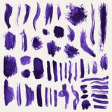 Collection of violet  abstract hand painted brush strokes and other elements. Royalty Free Stock Photo