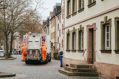 Daily collection of waste in Germany the city of Furth in Europe. Transportation of waste for subsequent disposal. Workers Stock Photos