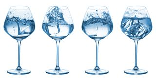 Collection of water splashing on glasses. Isolated over white background stock photos