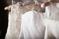 Collection of wedding dresses hanging on racks Royalty Free Stock Photos