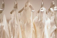 Collection of wedding dresses in a shop stock photos