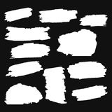 A collection white on a black background grungy abstract hand-painted brush strokes banner. Vector Royalty Free Stock Photos