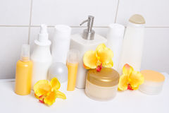 Collection of white cosmetic bottles and hygiene supplies with o Stock Images