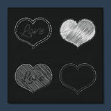 Collection of White Hearts on Chalkboard Background for a Valent. Collection of White Chalk Hearts on Chalkboard Background for a Valentine Day. Can be used for Stock Photo