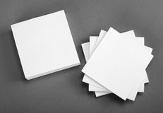 Collection of white note papers on gray background. Royalty Free Stock Image