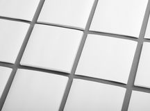 Collection of white note papers on gray background. Stock Photo