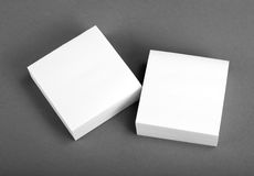 Collection of white note papers on gray background. Stock Photography