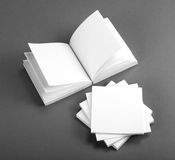 Collection of white note papers on gray background. Stock Photos