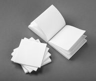 Collection of white note papers on gray background. Royalty Free Stock Photo