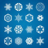 Collection of 16 white snowflakes on blue backgrou. Collection of 16 white snowflakes in different shapes Royalty Free Stock Image