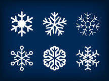 Collection of white vector snowflakes on blue Stock Photography